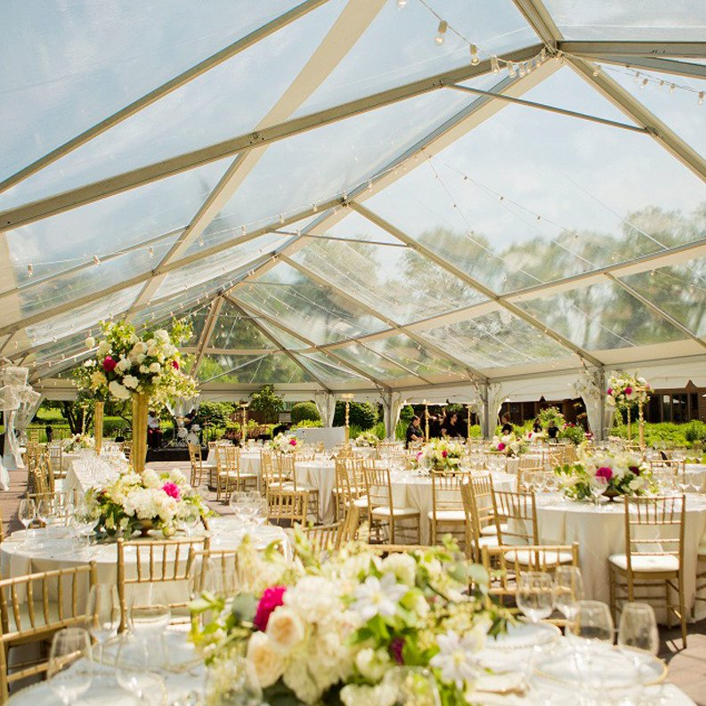 raxtent wedding tent with beautiful flowers and lights